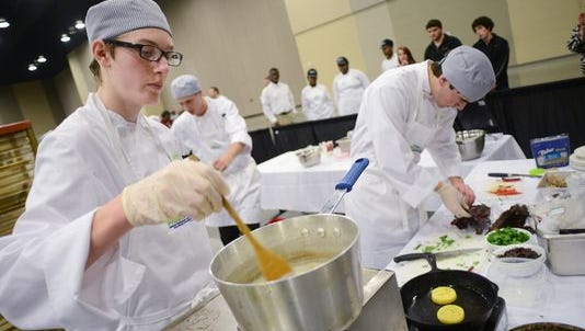 Tristan King, left, and his Lamar County teammates focus while hurrying to complete several dishes in an allotted 60 minutes during the MS ProStart Invitational competition Monday at the Jackson Convention Complex.