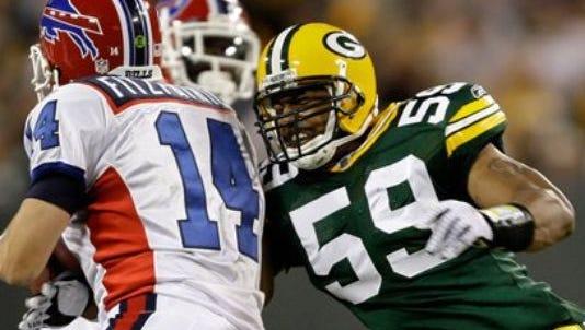 Green Bay Packers linebacker Brad Jones (59) sacks Buffalo Bills quarterback Ryan Fitzpatrick during the second half of an NFL preseason football game Saturday, Aug. 22, 2009, in Green Bay, Wis.