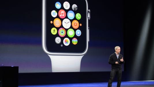 Tim Cook, CEO of Apple, tells the audience where the new Apple Watch will be sold during a program on March 9 at the Yerba Center for Performing Arts in San Francisco. Apple is suing an Amazon provider, saying many charging cables marketed as authentic pose dangers to consumers.