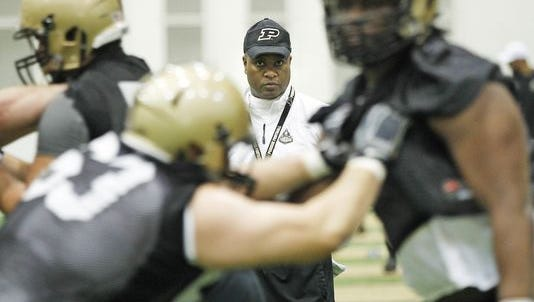Purdue coach Darrell Hazell watches linemen go through blocking drills during spring football practice Tuesday in the Mollenkopf Athletic Center.