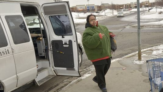 Nyeshia Johnson exits the Livonia Transit bus and begins her wait for the DDOT bus.