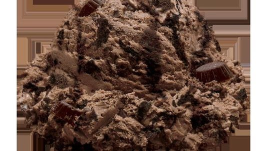 Ashby's Sterling Ice Cream's new flavor, Michigan Pot Hole, features stripes of black-tar fudge in dark chocolate ice cream laced with chunks of chocolate asphalt — also known as fudge cups.