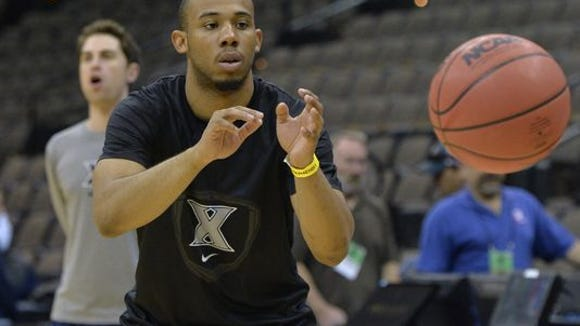 Xavier Musketeers guard Myles Davis reaches for a pass