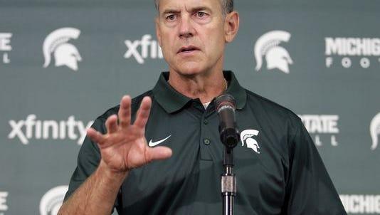 Michigan State football coach Mark Dantonio addresses the media Aug. 4, 2014.