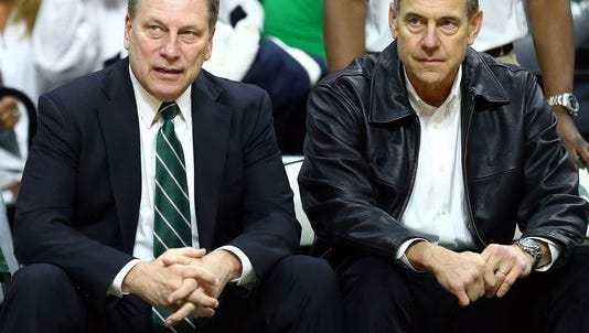 Michigan State basketball coach Tom Izzo and Spartans football head coach Mark Dantonio sit on the bench prior to the basketball game against the Michigan Wolverines at Breslin Center on Feb. 1.
