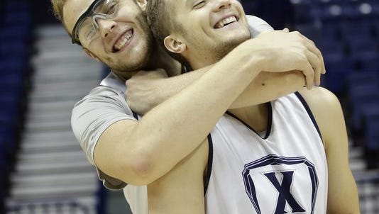Matt Stainbrook (left) gave his scholarship to his brother Tim (right), originally a walk-on, and started a part-time job as an Uber driver last fall. His story is still a hot topic in the NCAA tournament.