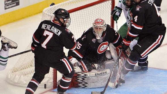 St. Cloud State's Niklas Nevalainen (7), Charlie Lindgren (35) and Ben Storm (4) try to hold off a threat on March 20 at the Target Center in Minneapolis.