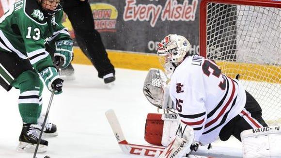 North Dakota's Connor Gaarder (13) shoots the puck on Charlie Lindgren at the Herb Brooks National Hockey Center.