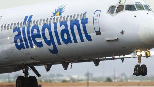 An Allegiant Airlines flight takes off at Williams Gateway Airport in Mesa, Thursday, July 17, 2014. The airline's pilots say they will strike on Thursday, April 2.