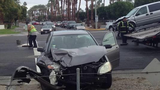 This file photo shows two vehicles damaged in a collision on East Palm Canyon Drive in Palm Springs. City officials want to identify hot spots for incidents involving vehicles, bicyclists and pedestrians.