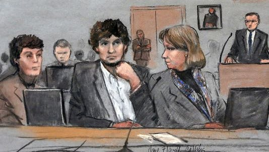 In this courtroom sketch, Dzhokhar Tsarnaev, center, is depicted between defense attorneys Miriam Conrad, left, and Judy Clarke during his federal death penalty trial in Boston.