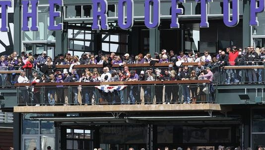 DENVER, CO - APRIL 04: Fans watch the Arizona Diamondbacks face the Colorado Rockies from 'The Rooftop' a new addition to the stadium during the home opener at Coors Field on April 4, 2014 in Denver, Colorado. The Rockies defeated the Diamondbacks 12-2. (Photo by Doug