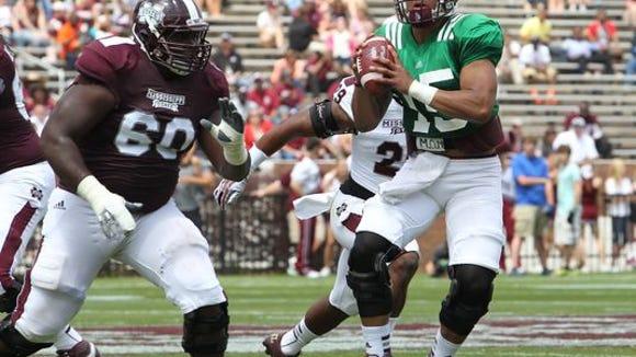Mississippi State quarterback Dak Prescott (right) and Jamaal Clayborn