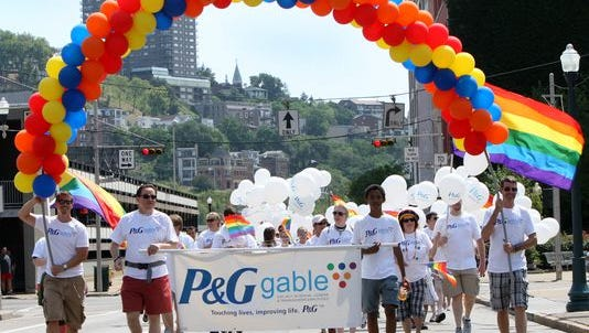 Members of Procter & Gamble's LGBT employee network, GABLE, march in the 2012 Gay Pride Parade in downtown Cincinnati.