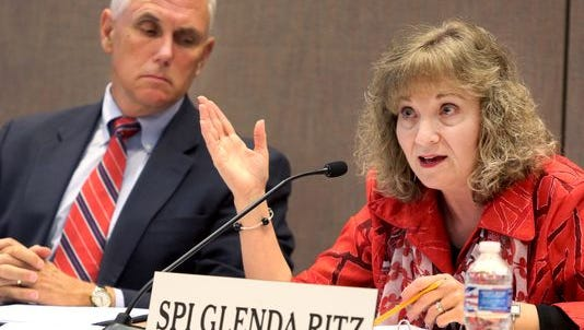 Gov. Mike Pence and Superintendent of Public Instruction Glenda Ritz have battled repeatedly over control of the state's education policy. Here they are shown at the Indiana Education Roundtable meeting on June 23, 2014.