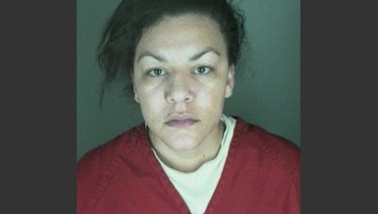 This undated booking photo provided by the Longmont Police Department shows Dynel Lane, 34, who is accused of stabbing a pregnant woman in the stomach and removing her baby, while the expectant mother visited her home to buy baby clothes advertised on Craigslist, authorities said.