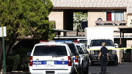 Law enforcement search an apartment in northwest Phoenix in connection with the shooting in Garland, Tx.