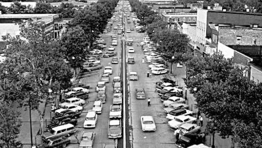 A 100-year-old Landis Avenue bustles with traffic and commerce in 1961, the year Vineland marked its Centennial.