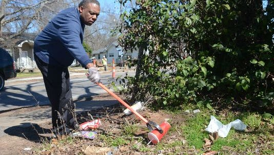 Alexandria City Councilman Roosevelt Johnson, shown picking up trash, is urging volunteers to join the Community Cleanup Day effort on Saturday in South Alexandria.