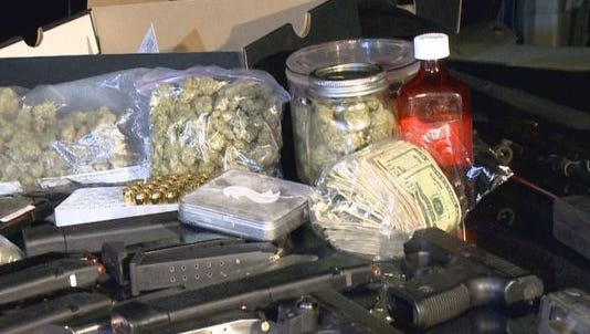 Police seized marijuana, cocaine, heroin and weapons during a raid on West Pages Lane Tuesday night.