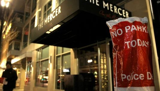 A Cincinnati parking meter is bagged and put out of service in front of The Mercer restaurant in Over-the-Rhine. The parking spots remain free and usable for Valet companies even though meter hours have increased and the spaces are taxpayer owned.