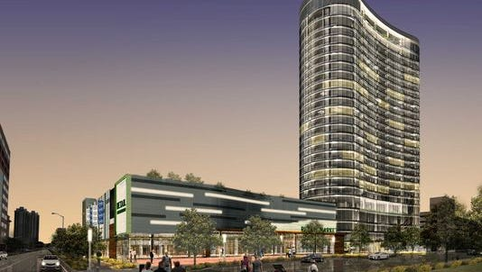 A rendering of the 28-story, $121 million, mixed-use luxury apartment tower with a Whole Foods Market.
