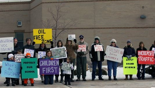 Demonstrators outside Bethke Elementary protest proposed oil and gas drilling near the school in January. Permits for the project were approved May 8. Helmick misrepresented the board's position on the controversial proposal to the Coloradoan.