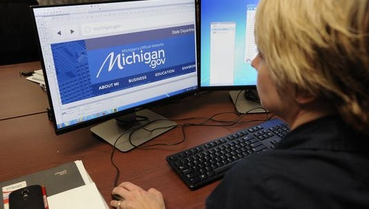 Web designer Ranee Bradish works  in her office with other web designers and state Department of Technology, Management & Budget employees in downtown Lansing on Thursday, May 21, 2015.