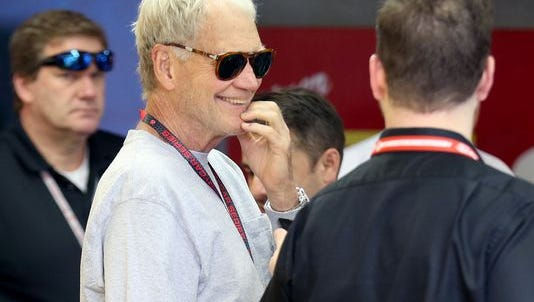 Team co-owner David Letterman chats in his garage area at Sunday's Indianapolis 500.