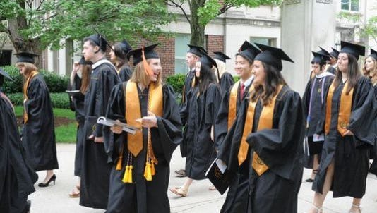 Graduates prepare for commencement on May 16 at Purdue University.