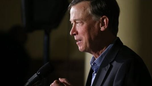 Colorado Gov. John Hickenlooper speaks to members of the media during a news conference at the Capitol in Denver on Thursday, Jan. 8, 2015.