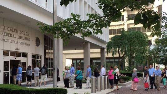 A line forms outside the federal courthouse in Wilmington Monday morning. Jury selection is set to begin Monday in U.S. District Court.