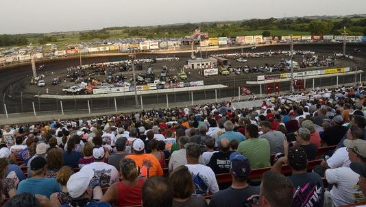 File photo of race fans watching the World of Outlaws sprint cars warm up at Huset's Speedway in Brandon, July 3, 2012.