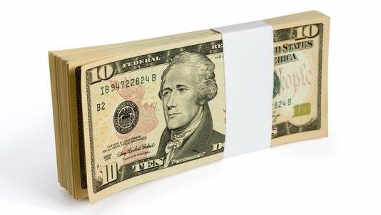 Wad of 10 dollar bank notes.