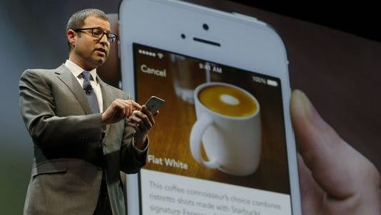 Adam Brotman, Starbucks chief digital officer, talks about the company's new mobile ordering app on March 18, 2015, at Starbucks Coffee Company's annual shareholders meeting in Seattle.