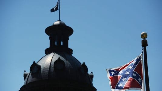Confederate flag flies near the South Carolina Statehouse on Friday.