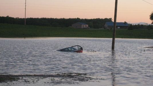 A car veered off a stretch of Charlotte Highway, just north of East Tupper Lake Road, into a flooded field.