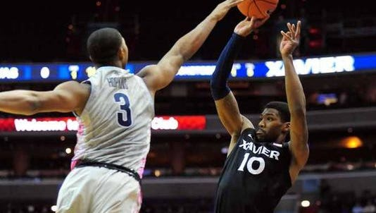 Remy Abell (right) is part of the core of veterans that returns to Xavier next year.