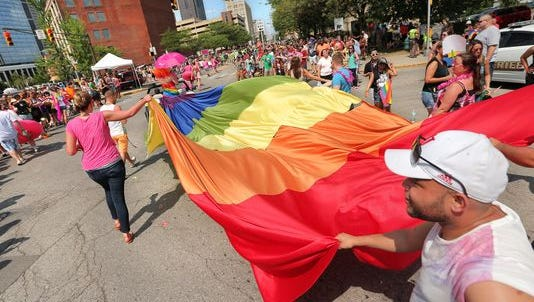 A gay pride flag follows takes the turn from Massachusetts Avenue to Vermont Street during the Circle City Pride Parade held in downtown Indianapolis on Saturday, June 13, 2015. The massive parade lasted two hours.