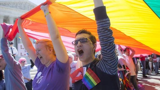 Katherine Struck, of Frederick, Maryland, and Aman Ardalan, of Annapolis, Maryland, shout support for gay marriage rights Tuesday in front of the Supreme Court in Washington. The writer hopes Michigan will allow same-sex marriage.