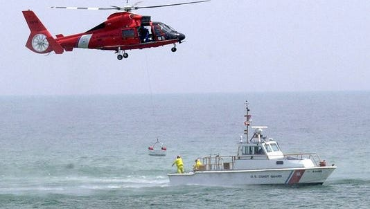The coast guard rescued three divers Sunday after they became separated from their boat.