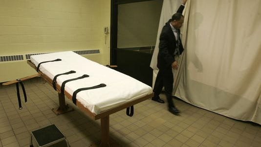 In this Nov. 2005 AP file photo, public information director Larry Greene is shown in the death chamber at the Southern Ohio Correctional Facility in Lucasville, Ohio.