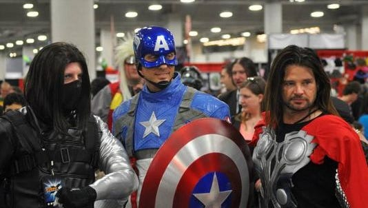 Cosplayers pose for a photo at Salt Lake Comic Con's FanXperience in 2014.