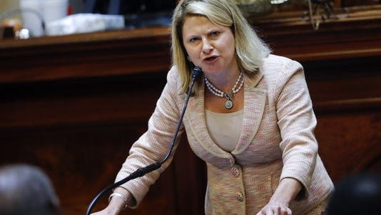 South Carolina state Rep. Jenny Horne, R-Summerville, gets emotional as she speaks during debate over a Senate bill calling for the Confederate flag to be removed from the Capitol grounds Wednesday, July 8, 2015, in Columbia, S.C.