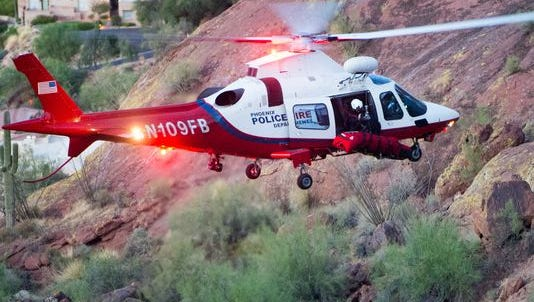 A helicopter crew in the Arizona desert. Search crews found the body of an English tourist who lost her way on Camelback Mountain late in the afternoon on Tuesday, July 7, 2015, in Phoenix.