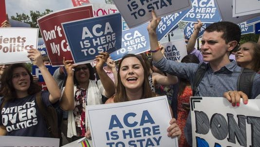 Supporters cheer the Supreme Court's ruling on the Affordable Care Act