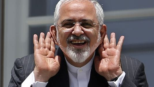 Iranian Foreign Minister Mohammad Javad Zarif gestures as he talks to journalist from a balcony of the Palais Coburg hotel where the Iran nuclear talks are being held in Vienna on July 10, 2015.