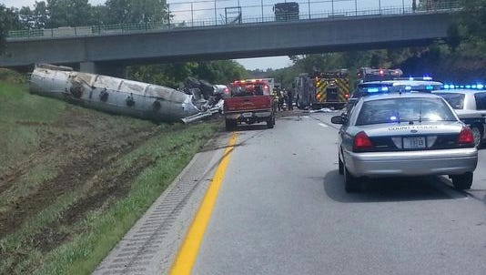 Scene of semi overturned on I-71 northbound near mile marker 21 in Oldham County.