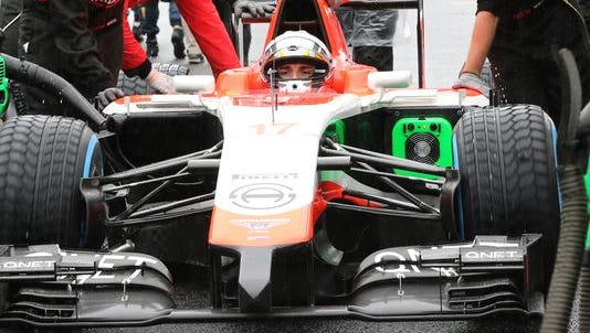 Jules Bianchi's No. 17 car is pushed to the grid before he took the start of the 2014 Japanese Grand Prix. Bianchi would die nine months later from injuries suffered from a crash in the race.
