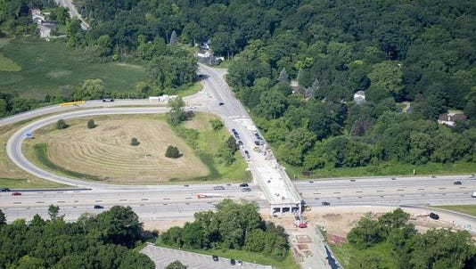 The Spencer Road bridge over Interstate 96 is open again.